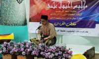 Peserta_Hafazan_Quran_WP_sedang_menyampaikan_bacaan.jpg